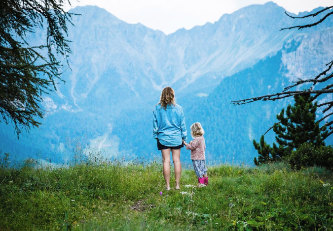 mother and daughter in mountains
